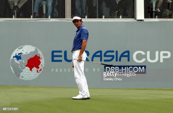 Gonzalo FdezCastano of Team Europe watches his putt on the 18th hole during the singles draw matches against Team Asia during day three of the...