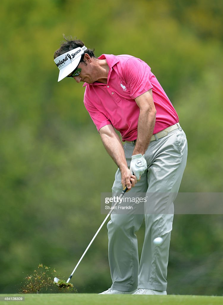 Gonzalo Fernandez Castano of Spain plays a shot during the third round of the Nedbank Golf Challenge at Gary Player CC on December 7, 2013 in Sun City, South Africa.
