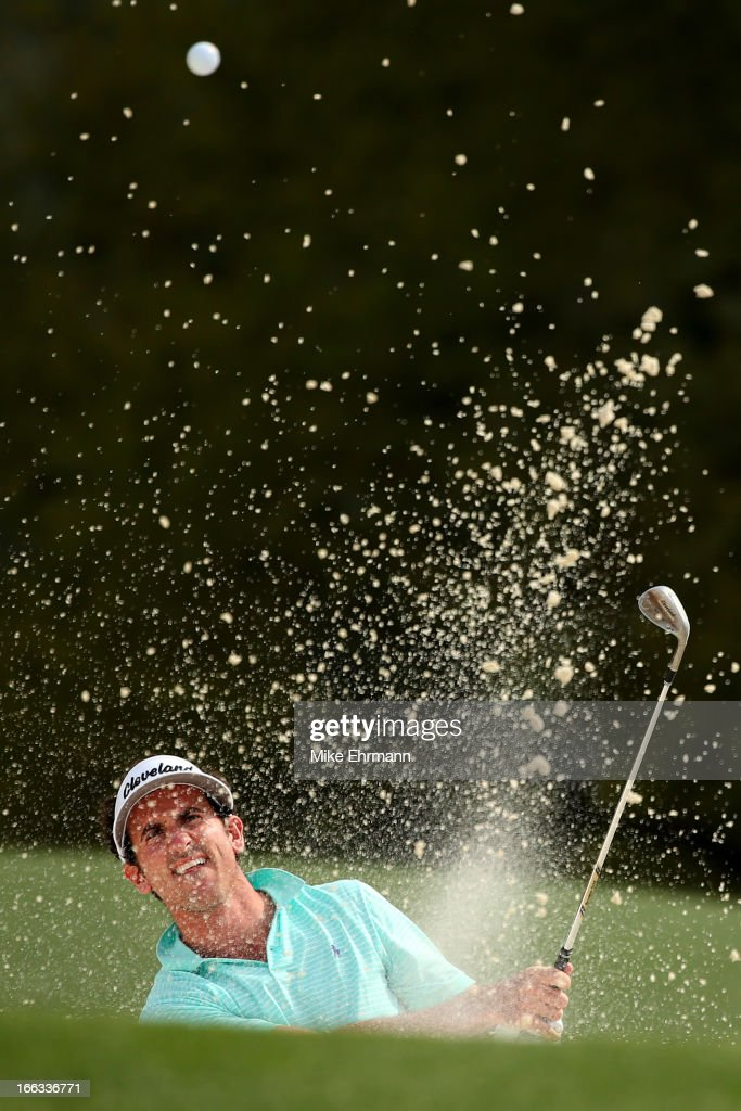 Gonzalo Fernandez-Castano of Spain hits out of a bunker on the 18th hole during the first round of the 2013 Masters Tournament at Augusta National Golf Club on April 11, 2013 in Augusta, Georgia.