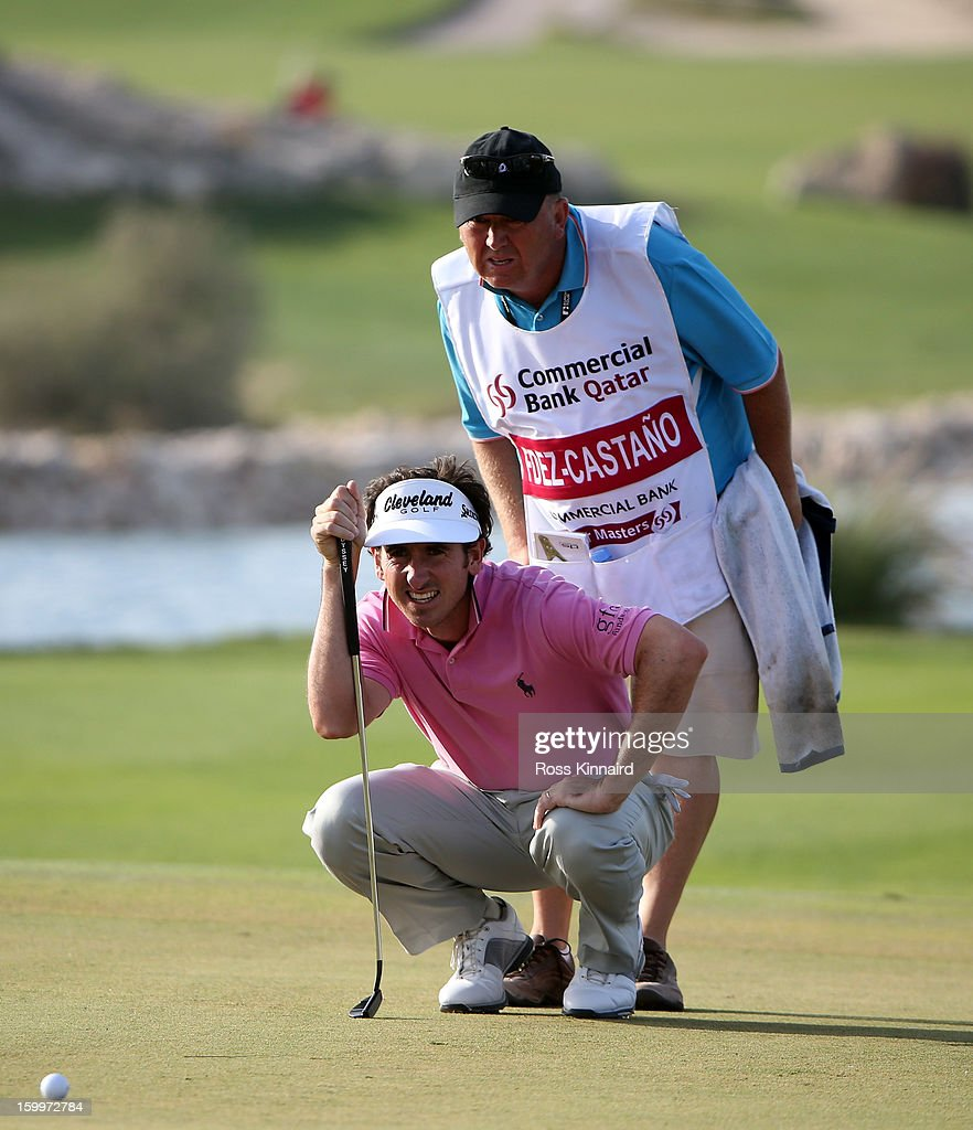 Gonzalo Fernandez-Castano of Spain lines up his putt with the help of his caddie during the second round of the Commercial Bank Qatar Masters at The Doha Golf Club on January 24, 2013 in Doha, Qatar.