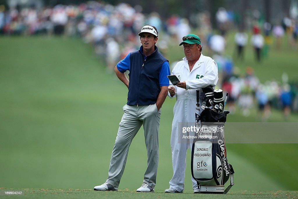 Gonzalo Fernandez-Castano of Spain waits alongside Jeffrey Paul during the second round of the 2013 Masters Tournament at Augusta National Golf Club on April 12, 2013 in Augusta, Georgia.