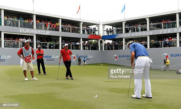Gonzalo FernandezCastano of Team Europe holes his put on the 18th green to tie his match against Hideto Tanihara of Team Europe which left the scores...