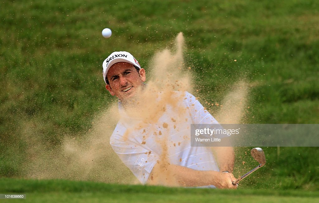 Gonzalo Fernendez-Castano of Spain plays out of the third greenside bunker during the third round of the Celtic Manor Wales Open on The Twenty Ten Course on June 5, 2010 in Newport, Wales.