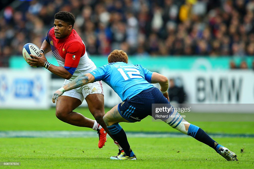 Gonzalo Garcia of Italy attempts to tackle Jonathan Danty of France during the RBS Six Nations match between France and Italy at Stade de France on February 6, 2016 in Paris, France.