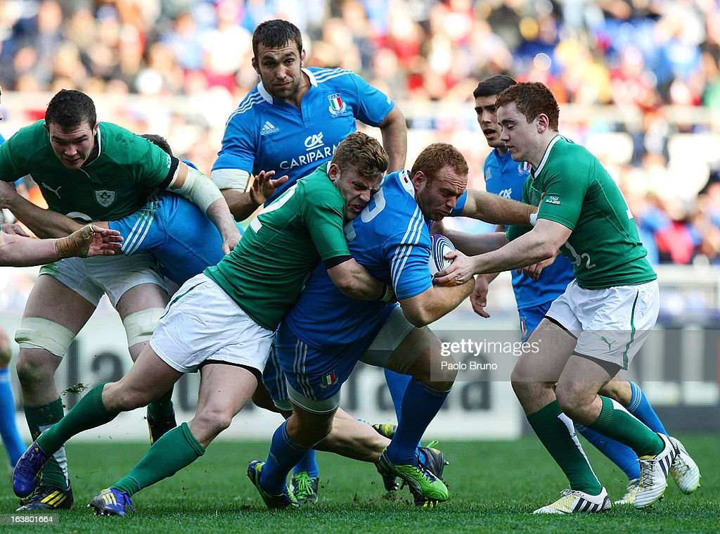 Gonzalo Garcia of Italy (C) is tackled during the RBS Six Nations match between Italy and Ireland at Stadio Olimpico on March 16, 2013 in Rome, Italy.