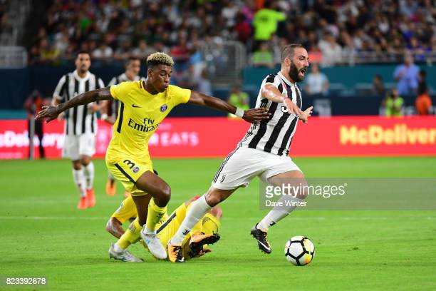 Gonzalo Gerardo Higuain of Juventus brings the ball away from Marco Verratti of PSG and Kimpembe Presnel of PSG during the International Champions...