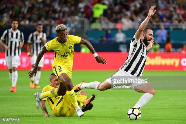 Gonzalo Gerardo Higuain of Juventus is fouled by Kimpembe Presnel of PSG and Marco Verratti of PSG during the International Champions Cup match...
