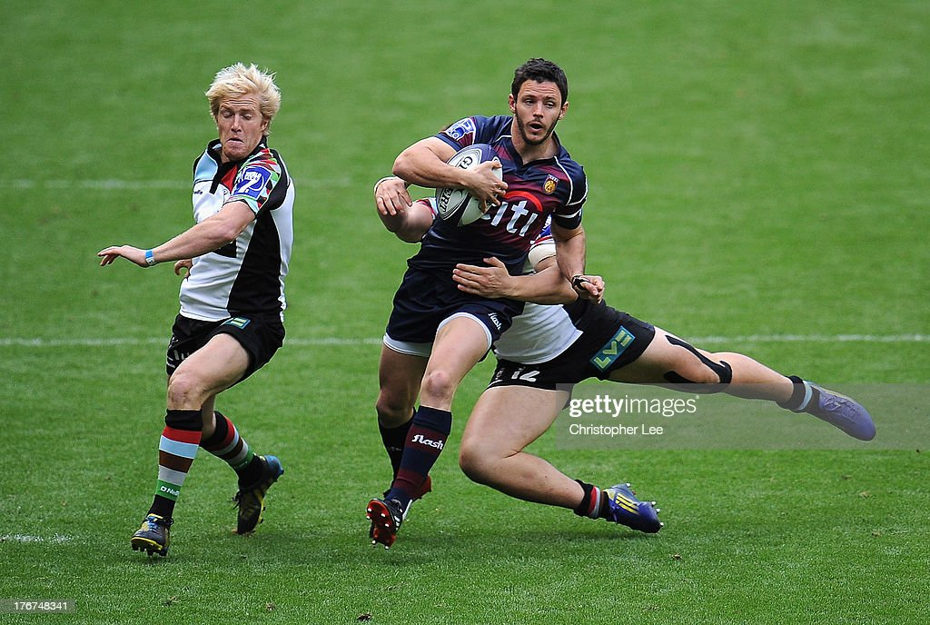 Gonzalo Gutuerrez Taboda of Buenos Aires gets away from Jack Clifford (Floor) and Freddie Strange of Harlequins during the 3rd / 4th place match between Harlequins and Buenos Aires in the World Club 7's 2013 at Twickenham Stadium on August 18, 2013 in London, England.