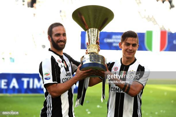 Gonzalo Higiuain and Paulo Dybala of Juventus pose the 'Scudetto' trophy to celebrate the win of the Italian Serie A 2016/2017 at the end of the...