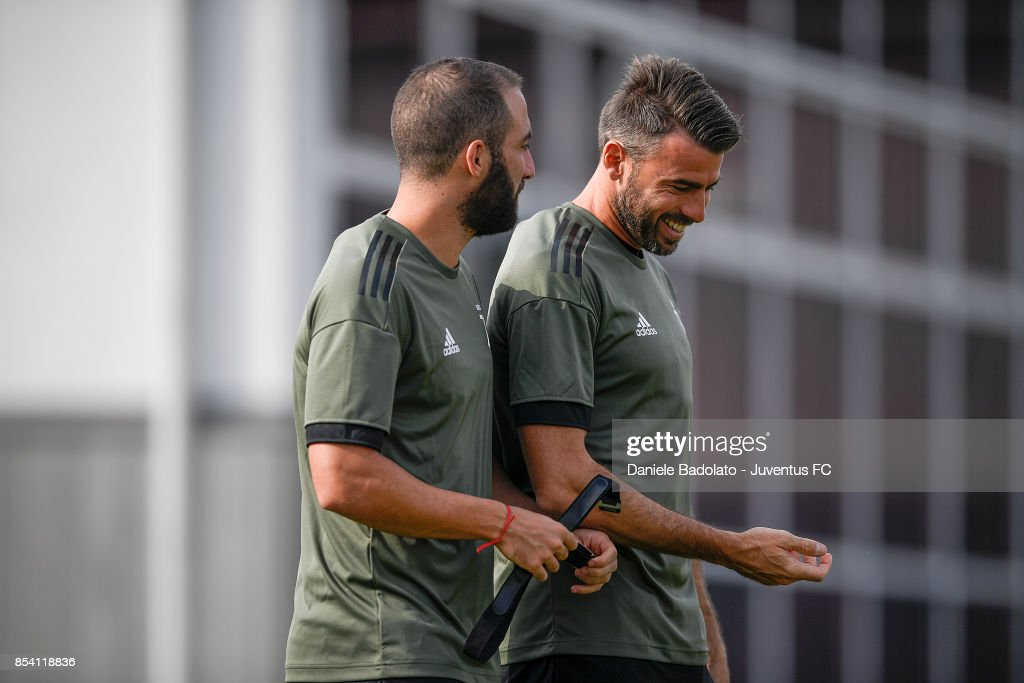 Gonzalo Higuain and Andrea Barzagli during a Juventus Training Session at Juventus Center Vinovo on September 26, 2017 in Vinovo, Italy.