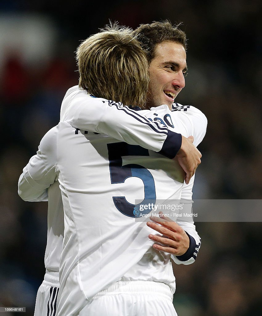 <a gi-track='captionPersonalityLinkClicked' href=/galleries/search?phrase=Gonzalo+Higuain&family=editorial&specificpeople=651523 ng-click='$event.stopPropagation()'>Gonzalo Higuain</a> (R) and Fabio Coentrao of Real Madrid celebrate their second goal during the Copa del Rey Quarter Final match between Real Madrid and Valencia at Estadio Santiago Bernabeu on January 15, 2013 in Madrid, Spain.