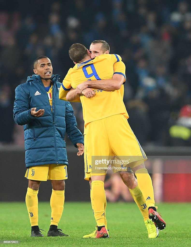 Gonzalo Higuain and Giorgio Chiellini players of Juventus celebrate the victory after the Serie A match between SSC Napoli and Juventus at Stadio San Paolo on December 1, 2017 in Naples, Italy.