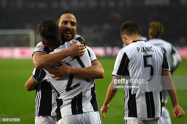 Gonzalo Higuain and Paulo Dybala of Juventus FC celebrate victory at the end of the Serie A match between FC Torino and Juventus FC at Stadio...