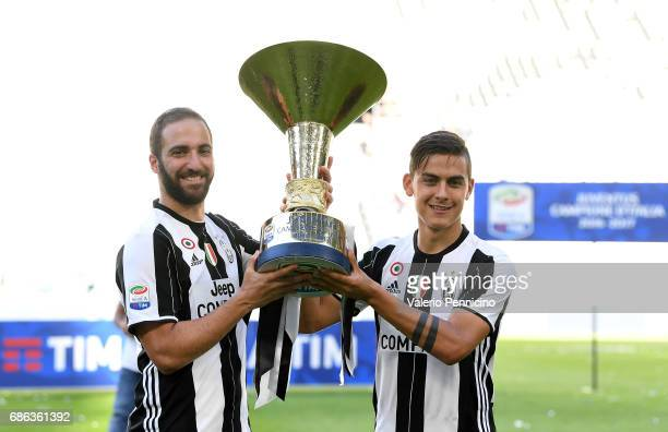Gonzalo Higuain and Paulo Dybala of Juventus FC celebrate with the trophy after the beating FC Crotone 30 to win the Serie A Championships at the end...