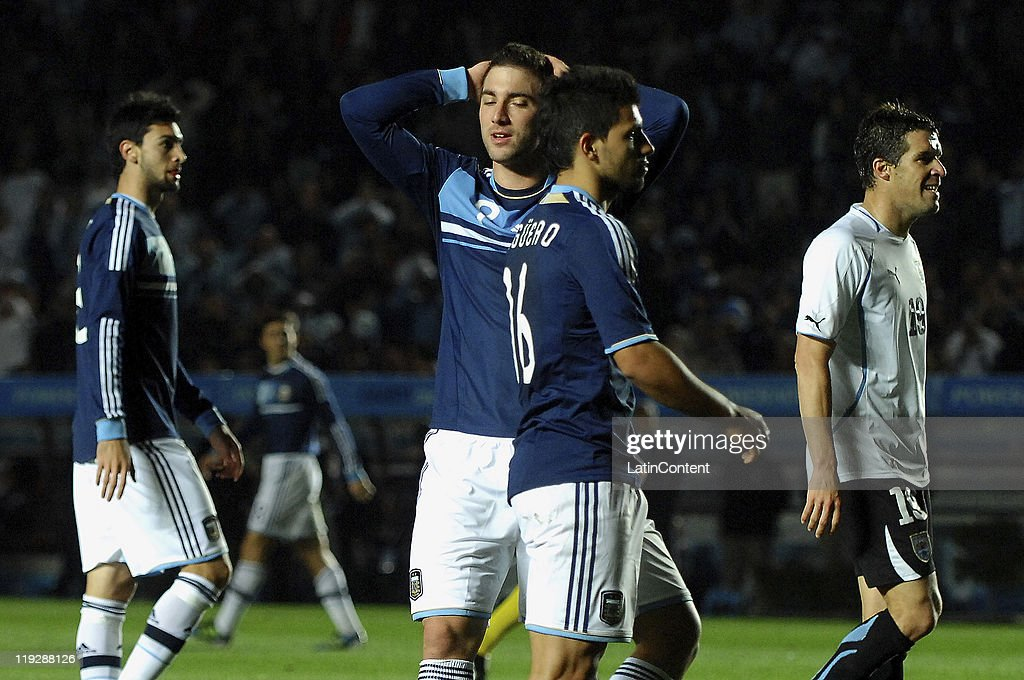 FE, ARGENTINA, JULY 16 - <a gi-track='captionPersonalityLinkClicked' href=/galleries/search?phrase=Gonzalo+Higuain&family=editorial&specificpeople=651523 ng-click='$event.stopPropagation()'>Gonzalo Higuain</a> and Sergio Agüero of Argentina reacts during a match as part of Finals Quarters of 2011 Copa America at Brigadier Lopez Stadium on July 16, 2011 in Santa Fe, Argentina