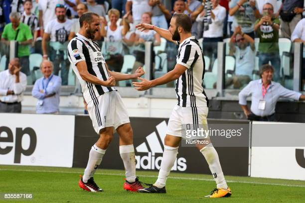 Gonzalo Higuain celebrates after scoring with Giorgio Chiellini during the Serie A football match between Juventus FC and Cagliari Calcio at Allianz...