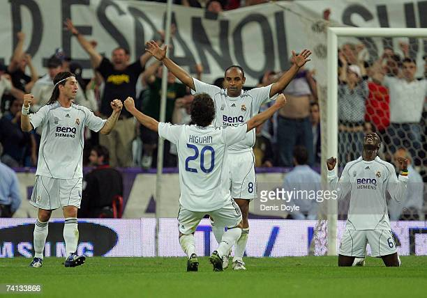 Gonzalo Higuain Emerson Sergio Ramos and Mahamadou Diarra of Real Madrid celebrate after they beat Espanyol 43 during the Primera Liga match between...