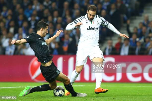 Gonzalo Higuain forward of Juventus FC vies with Porto's Spanish defender Ivan Marcano during the UEFA Champions League Round of 16 1st leg soccer...