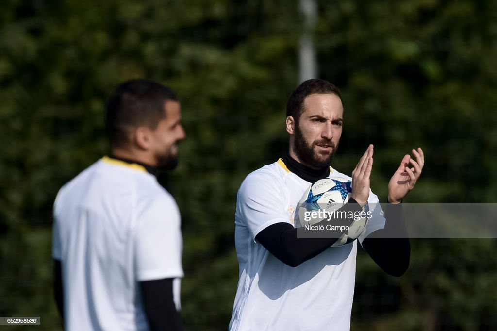 Gonzalo Higuain (right) gestures during the Juventus FC training on the eve of the UEFA Champions League football match between Juventus FC and FC Porto.