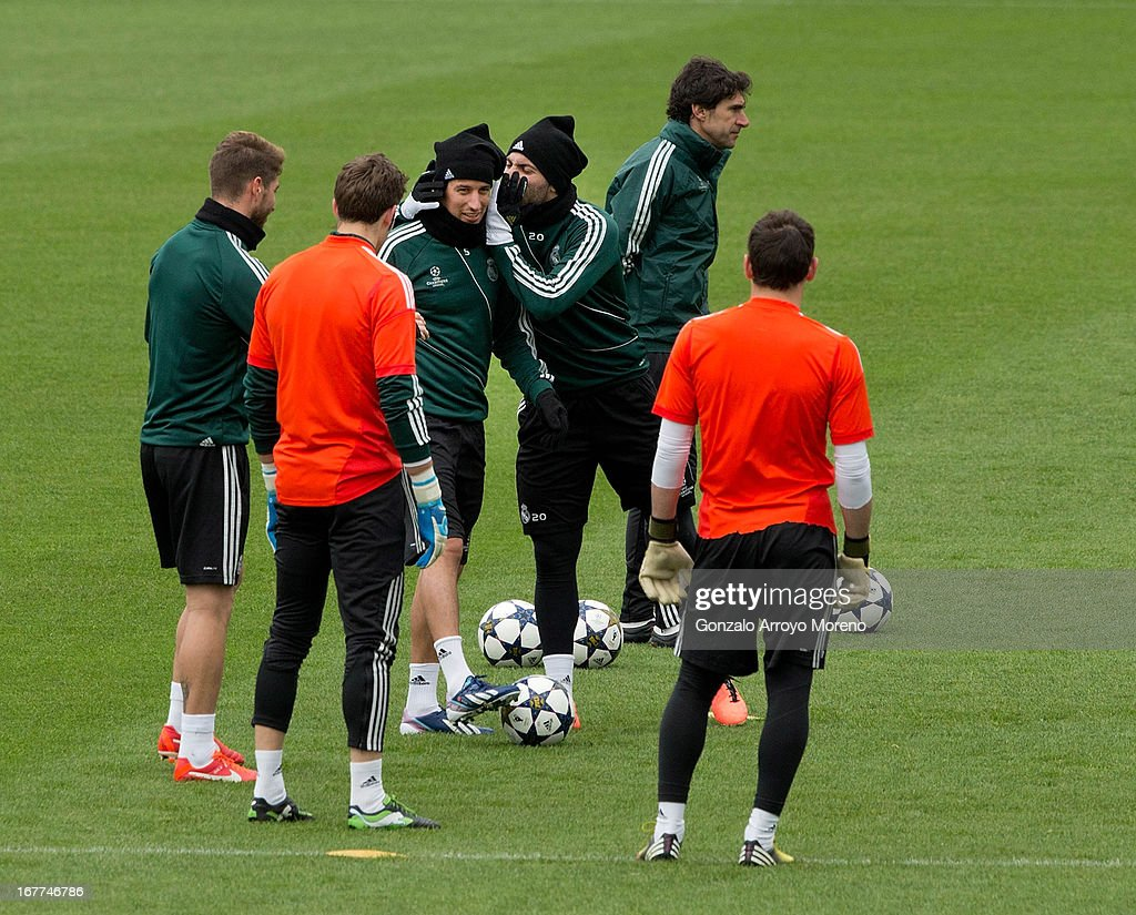 Gonzalo Higuain jokes with Fabio Coentrao as assistant coach Aitor Karanka looks on during a training session ahead of the UEFA Champions League Semifinal second leg match between Real Madrid and Borussia Dortmund at the Valdebebas training ground on April 29, 2013 in Madrid, Spain.