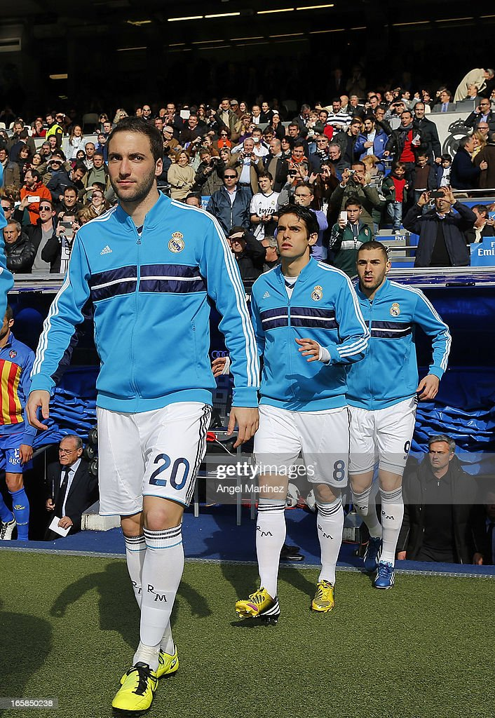 Gonzalo Higuain, Kaka and Karim Benzema of Real Madrid walk onto the pitch before the La Liga match between Real Madrid and Levante at Estadio Santiago Bernabeu on April 6, 2013 in Madrid, Spain.