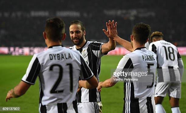 Gonzalo Higuain Miralem Pjanic and Paulo Dybala of Juventus FC celebrate victory at the end of the Serie A match between FC Torino and Juventus FC at...