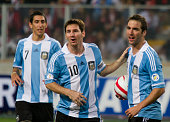 Gonzalo Higuain of Argentina celebrates a goal with Lionel Messi during a match between Argentina and Perú as part of the South American Qualifiers...