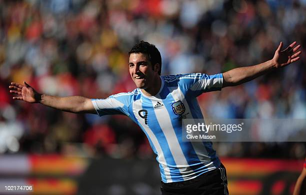 Gonzalo Higuain of Argentina celebrates scoring his second goal during the 2010 FIFA World Cup South Africa Group B match between Argentina and South...