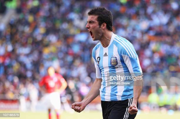 Gonzalo Higuain of Argentina celebrates scoring his side's second goal during the 2010 FIFA World Cup South Africa Group B match between Argentina...