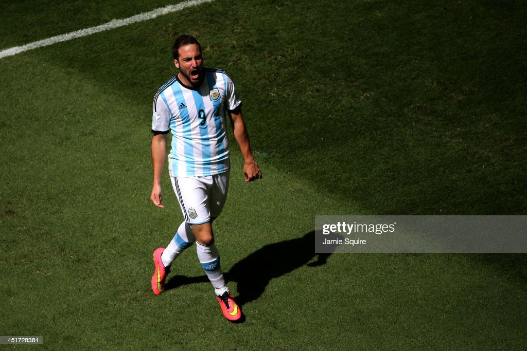 <a gi-track='captionPersonalityLinkClicked' href=/galleries/search?phrase=Gonzalo+Higuain&family=editorial&specificpeople=651523 ng-click='$event.stopPropagation()'>Gonzalo Higuain</a> of Argentina celebrates scoring his team's first goal during the 2014 FIFA World Cup Brazil Quarter Final match between Argentina and Belgium at Estadio Nacional on July 5, 2014 in Brasilia, Brazil.