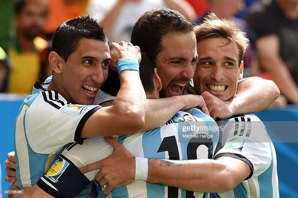 <a gi-track='captionPersonalityLinkClicked' href=/galleries/search?phrase=Gonzalo+Higuain&family=editorial&specificpeople=651523 ng-click='$event.stopPropagation()'>Gonzalo Higuain</a> of Argentina (2nd L) celebrates scoring his team's first goal with Angel di Maria (L), <a gi-track='captionPersonalityLinkClicked' href=/galleries/search?phrase=Lionel+Messi&family=editorial&specificpeople=453305 ng-click='$event.stopPropagation()'>Lionel Messi</a> (2nd L) and <a gi-track='captionPersonalityLinkClicked' href=/galleries/search?phrase=Lucas+Biglia&family=editorial&specificpeople=627651 ng-click='$event.stopPropagation()'>Lucas Biglia</a> during the 2014 FIFA World Cup Brazil Quarter Final match between Argentina and Belgium at Estadio Nacional on July 5, 2014 in Brasilia, Brazil.