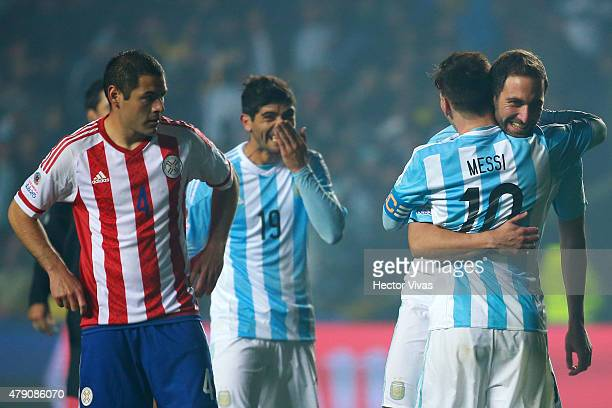 Gonzalo Higuain of Argentina celebrates with teammate Lionel Messi after scoring the sixth goal of his team during the 2015 Copa America Chile Semi...