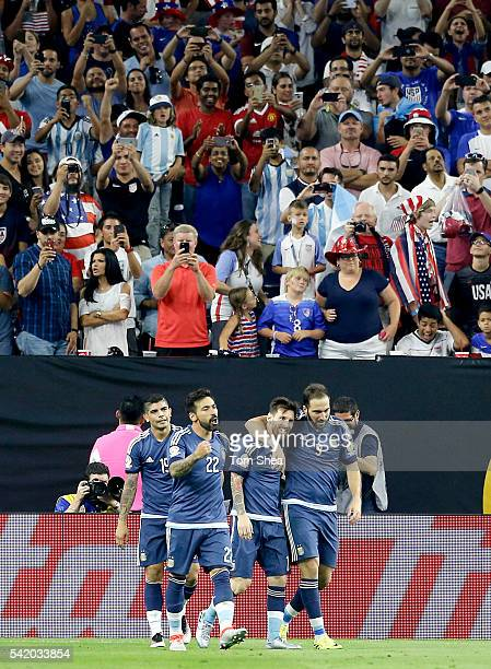 Gonzalo Higuain of Argentina celebrates with teammates after scoring the third goal of his team during the Semifinal match between United States and...