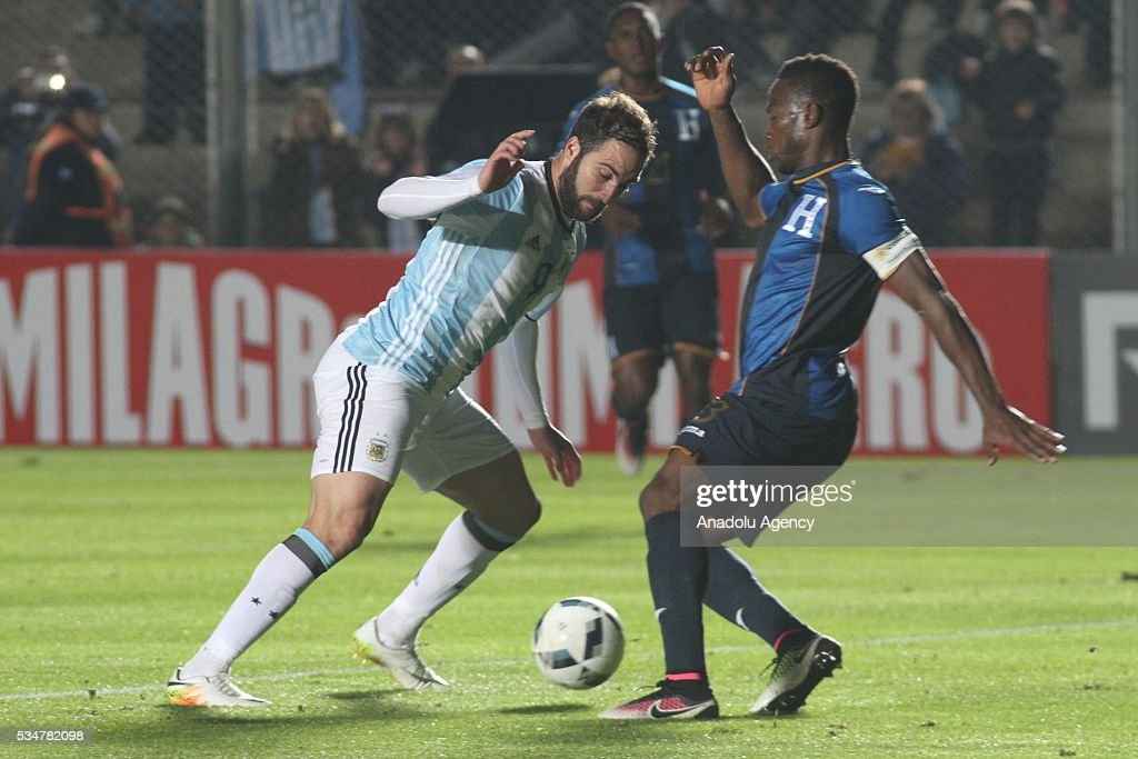 Gonzalo Higuain of Argentina (L) in action during a friendly game between Argentina and Honduras at Bicentenario stadium in San Juan, Argentina on May 27, 2016.