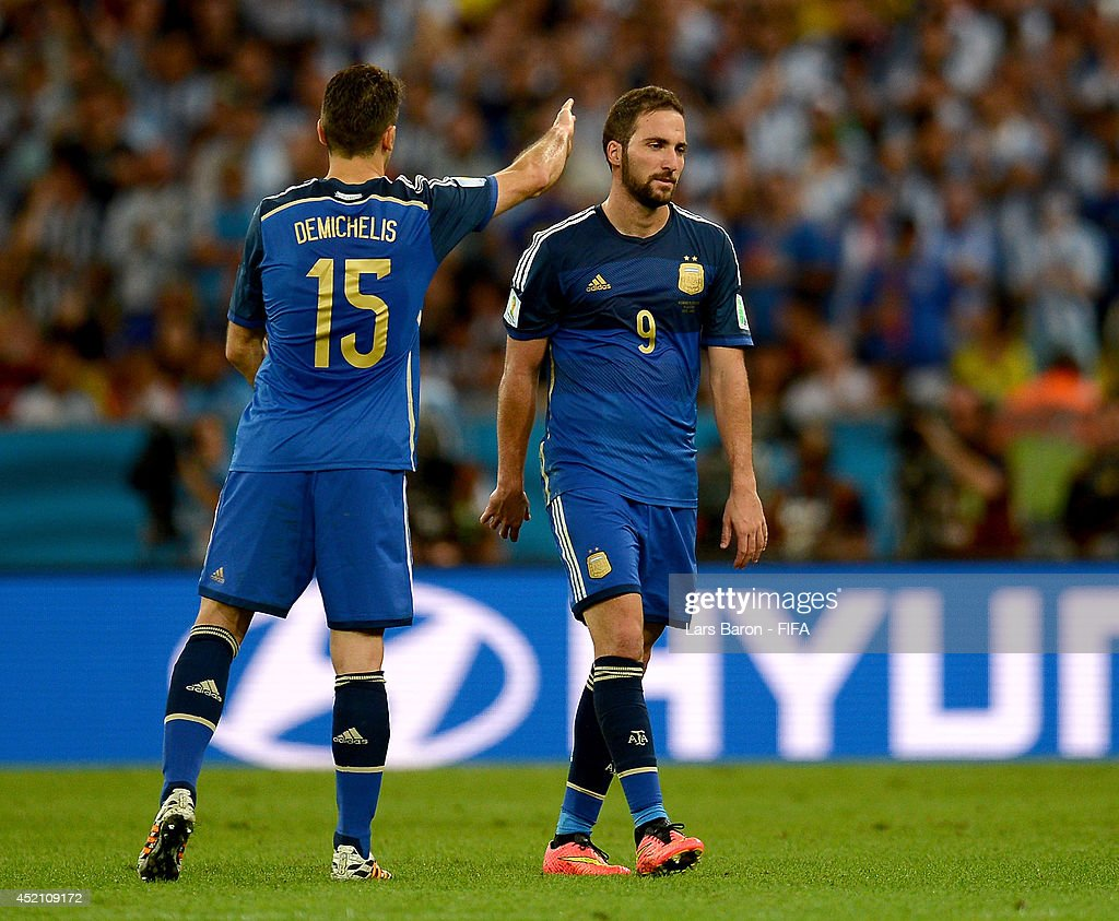 Gonzalo Higuain of Argentina is greeted by his teammate Martin Demichelis as he is replaced during the 2014 FIFA World Cup Brazil Final match between Germany and Argentina at Maracana on July 13, 2014 in Rio de Janeiro, Brazil.