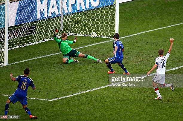 Gonzalo Higuain of Argentina scores a goal past Manuel Neuer of Germany but it is disallowed due to offsides being called during the 2014 FIFA World...