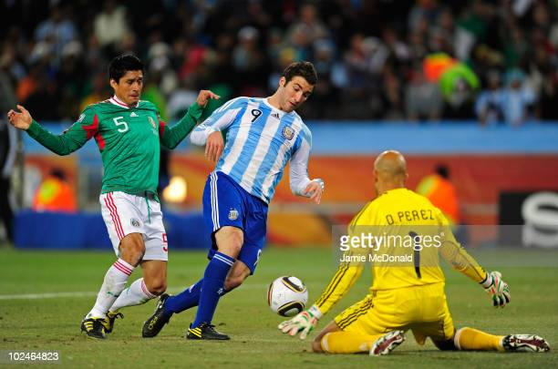 Gonzalo Higuain of Argentina scores his side's second goal past Oscar Perez of Mexico during the 2010 FIFA World Cup South Africa Round of Sixteen...