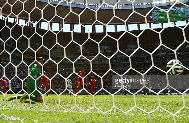 Gonzalo Higuain of Argentina scores his team's first goal past Thibaut Courtois of Belgium during the 2014 FIFA World Cup Brazil Quarter Final match...