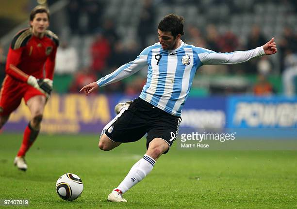 Gonzalo Higuain of Argentina scores his team's opening goal during the International Friendly match between Germany and Argentina at the Allianz...