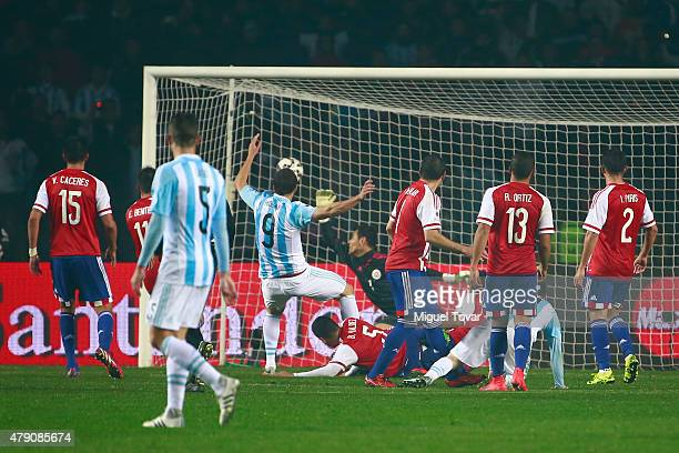 Gonzalo Higuain of Argentina shoots the ball to score the sixth goal of his team during the 2015 Copa America Chile Semi Final match between...