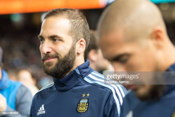 Gonzalo Higuain of Argentina walks onto the field before a friendly football international between Argentina and Brazil at the Melbourne Cricket...