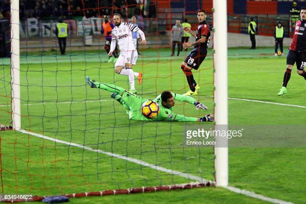 Gonzalo Higuain of Juventu sscores his goal 02 during the Serie A match between Cagliari Calcio and Juventus FC at Stadio Sant'Elia on February 12...