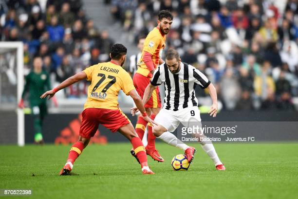 Gonzalo Higuain of Juventus and Achraf Lazaar of Benevento compete for the ball during the Serie A match between Juventus and Benevento Calcio on...