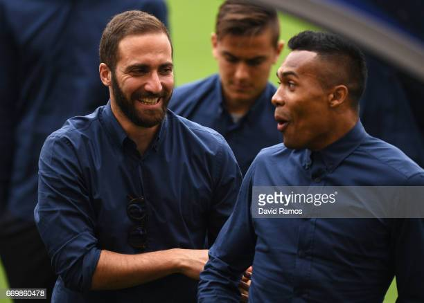 Gonzalo Higuain of Juventus and Alex Sandro of Juventus walk in from looking at the pitch prior to the Juventus press conference at the Camp Nou on...