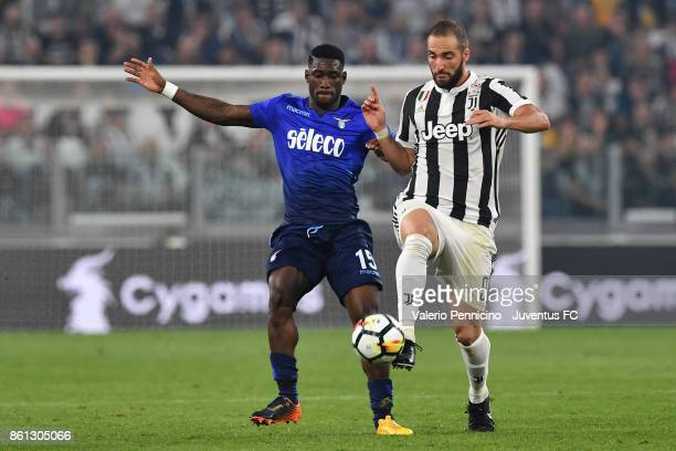 Gonzalo Higuain of Juventus and Bastos of Lazio competes for the ball during the Serie A match between Juventus and SS Lazio on October 14 2017 in...
