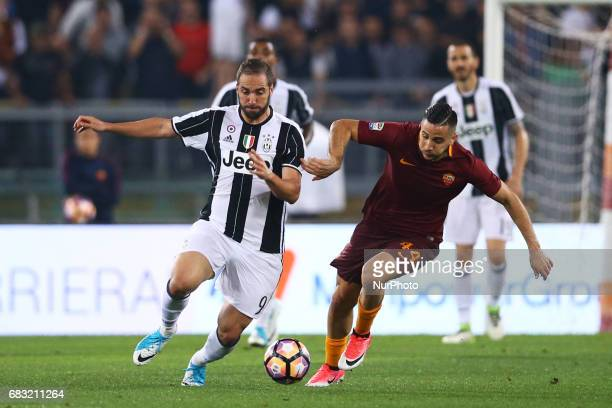 Gonzalo Higuain of Juventus and Konstantinos Manolas of Roma during the Serie A match between AS Roma and Juventus FC at Stadio Olimpico on May 14...