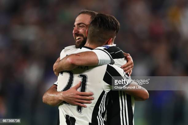Gonzalo Higuain of Juventus and Paulo Dybala embrace at the end of the UEFA Champions League Quarter Final first leg match between Juventus and FC...
