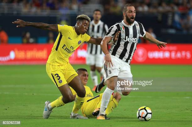 Gonzalo Higuain of Juventus and Presnel Kimpembe of Paris SaintGermain fightr for the ball during the International Champions Cup 2017 match at Hard...