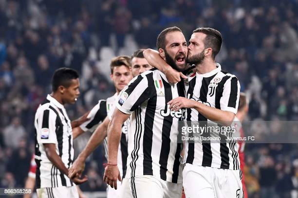 Gonzalo Higuain of Juventus celebrates after scoring his first goal during the Serie A match between Juventus and Spal on October 25 2017 in Turin...