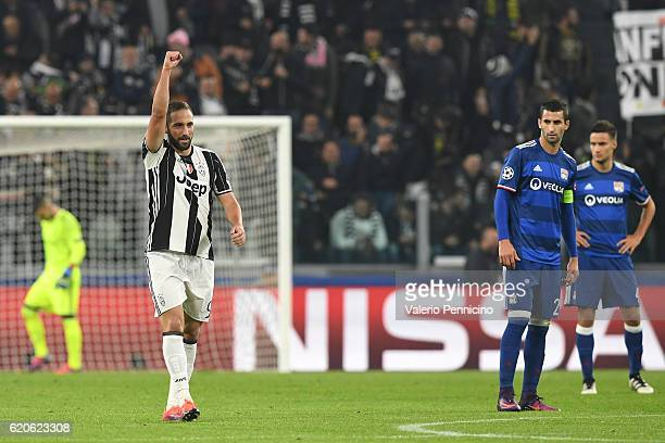 Gonzalo Higuain of Juventus celebrates after scoring the opening goal from the penalty spot during the UEFA Champions League Group H match between...